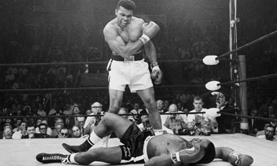 Muhammad Ali looks at Sonny Liston on the canvas.