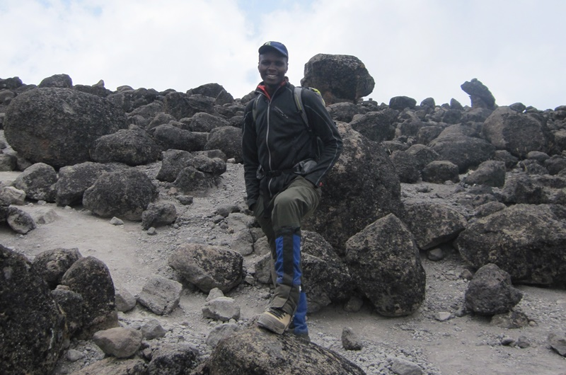 Simon Mtuy: Among volcanic rocks.